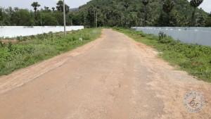 road facing vuda plots nr pend